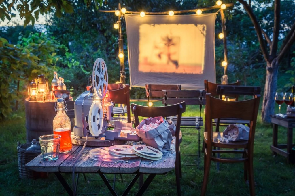 Film canvas and wooden chairs in a garden.